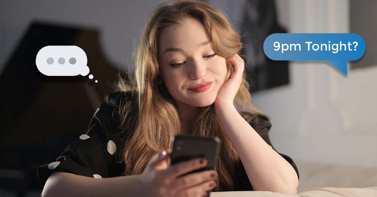 How to ask a girl out - Undecided girl texting on bed